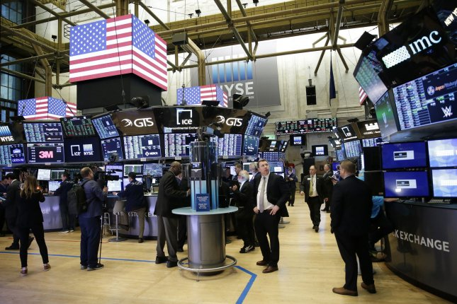 Traders work on the the floor of the New York Stock Exchange Tuesday at the opening bell on Wall Street in New York City. Photo by John Angelillo/UPI