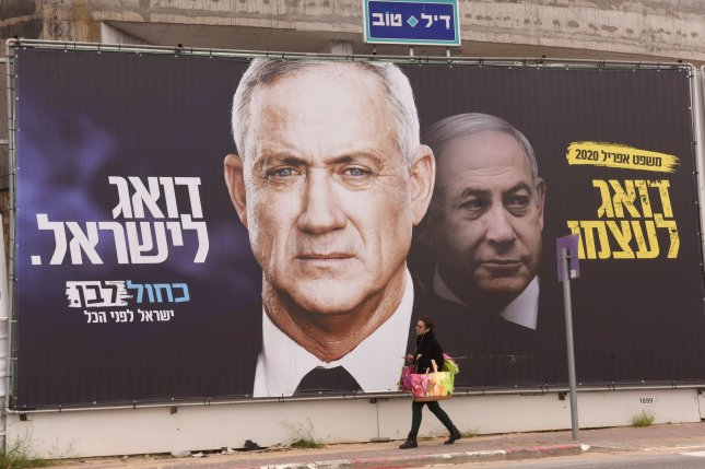 A campaign advertisement for Benny Gantz's Blue and White Party is seen February 23 in Ramat Gan, Israel. He and Prime Minister Benjamin Netanyahu are working to form a coalition government after national elections last month. File Photo by Debbie Hill/UPI