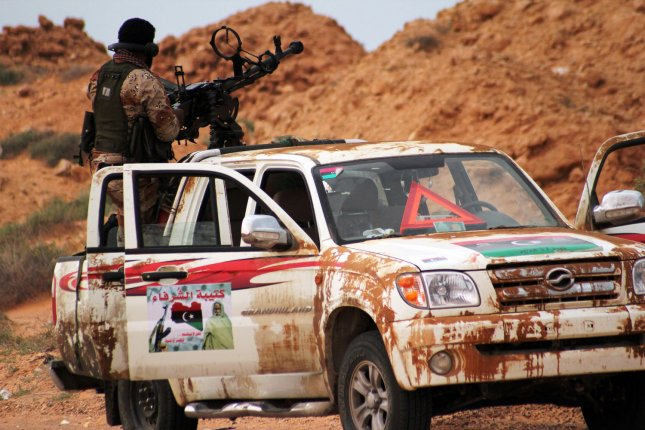 Libyan rebels take their positions after fighting with pro-Gadhafi forces in the western city of Ajdabiya, Libya on April 13, 2011. UPI/Tarek Alhuony