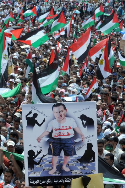 An Egyptian demonstrator holds a poster calling for the trial of ousted president Hosni Mubarak as thousands gather gather at Cairo's Tahrir Square and hold flags of Egypt and Palestine on May 13, 2011 during a protest calling for national unity after attacks on Egyptian churches, and solidarity with the Palestinians as they mark the Nakba or catastrophe which they call the establishment of the Israeli state in 1948. UPI/Mohammed Hosam