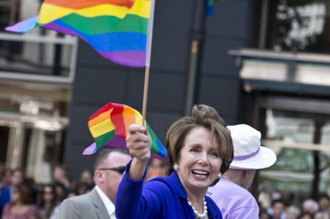 Rep. Nancy Pelosi (D-CA) waves a flag in the annual LGBT Pride Parade to in San Francisco. UPI/Terry Schmitt