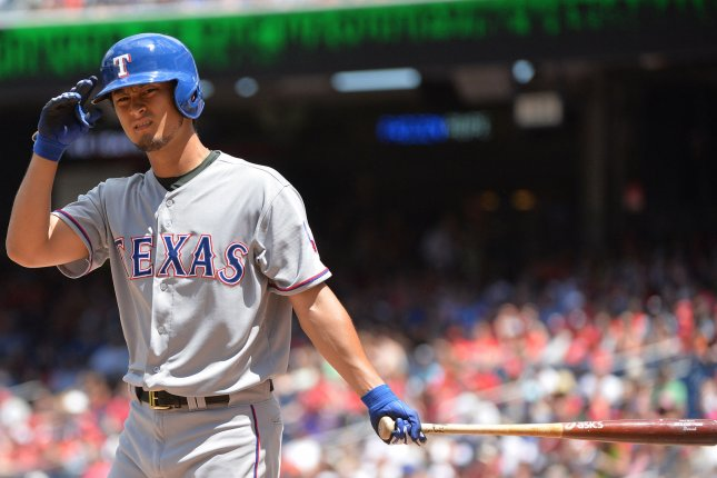 Texas Rangers Yu Darvish prepares to bat in the second inning against the Washington Nationals at Nationals Park in Washington, D.C. on June 1, 2014. (File/UPI/Kevin Dietsch)