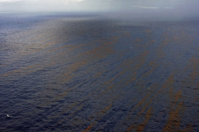 Oil creates a pattern in the water of the Gulf of Mexico, July 3, 2010 near the BP Deepwater Horizon accident site. New research suggests dispersants used to encourage the oil's breakdown by microbes may not have actually hindered the natural process. File Photo by A.J. Sisco/UPI