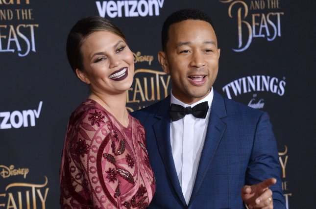 John Legend (R) and Chrissy Teigen attend the Los Angeles premiere of Beauty and the Beast on March 2. The singer serenaded commuters Wednesday at the St. Pancras railway station in London. File Photo by Jim Ruymen/UPI