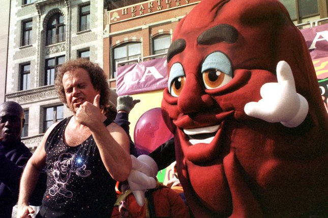 Fitness maven Richard Simmons introduces and exercises with a California Raisin character on February 10, 2000. Simmons turns 69 on July 12. File Photo by Ezio Petersen/UPI