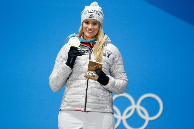Women's Singles Luge gold medalist Natalie Geisenberger of Germany celebrates on the podium at the medals ceremony for the 2018 Pyeongchang Winter Olympics Wednesday at the Pyeongchang Medals Plaza in Pyeongchang, South Korea. Photo by Matthew Healey/UPI