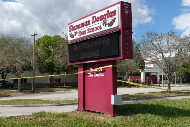 A sign telling students where they can get grief counseling is displayed outside of the Marjory Stoneman Douglas High School on February 18, 2018 in Parkland, Florida. The school will only allow students in the future to use clear backpacks on its campus. File Photo by Gary Rothstein/UPI