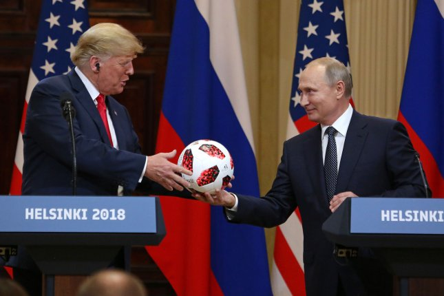 U.S. President Donald Trump (L) receives a soccer ball from Russian President Vladimir Putin during a joint press conference in Helsinki, Finland on Monday. Photo by David Silpa/UPI