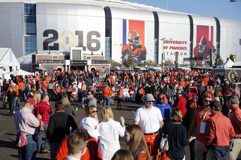 Fans gather outside of University of Phoenix Stadium before the 2016 College Football Playoff National Championship Game on January 11, 2016 in Glendale, Arizona. File photo by John Rinehart/UPI