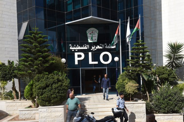 Palestinians stand outside Palestinian Liberation Organization headquarters in Ramallah, West Bank, on Monday. Photo by Debbie Hill/UPI