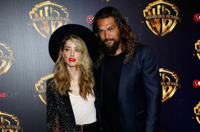 Aquaman co-stars Jason Momoa (R) and Amber Heard appear in new character posters for the film. File Photo by James Atoa/UPI
