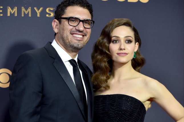 Sam Esmail (L) -- pictured here with actress Emmy Rossum -- is executive producing a new version of Battlestar Galactica. File Photo by Christine Chew/UPI