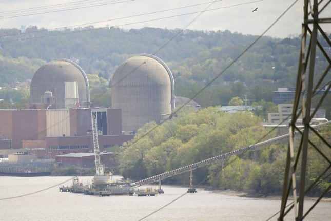 The cooling towers of Indian Point nuclear power plant sit along the Hudson River on Friday. Entergy Corporation's Indian Point will shut down today after nearly 60 years of nuclear power generation at the site in New York state. Photo by John Angelillo/UPI