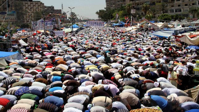 Supporters of deposed Egyptian President Mohamed Morsi pray during a protest outside Raba El-Adwyia mosque in Cairo in Egypt, July 26, 2013. Dozens of people have been killed in overnight clashes between security forces and supporters of ousted Egyptian President Mohammed Morsi. UPI/Ahmed Jomaa