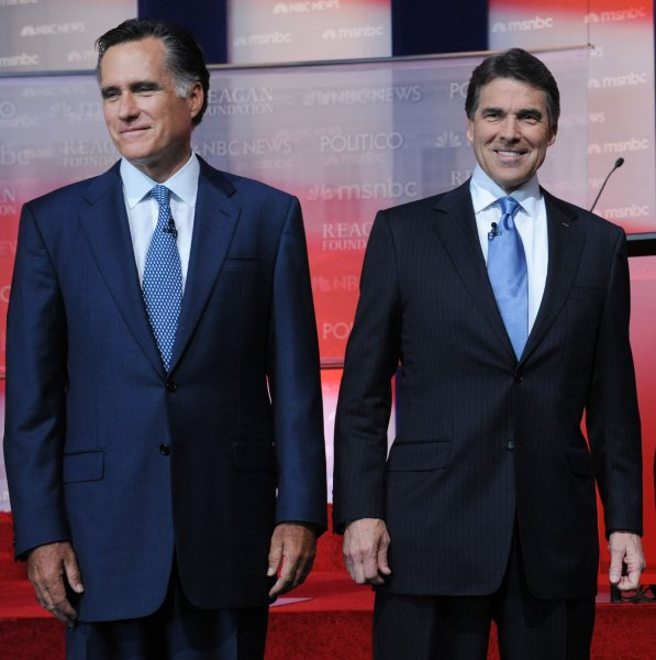 Presidential candidates Mitt Romney (L) and Rick Perry arrive on stage before the start of the Republican presidential primary debate at the Ronald Reagan Presidential Library in Simi Valley, Calif., Sept. 7, 2011. UPI/Jim Ruymen
