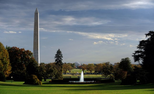 Clouds clear above the Washington Monument and Jefferson Memorial as seen from the South Lawn of the White House in Washington on October 27, 2010. UPI/Roger L. Wollenberg