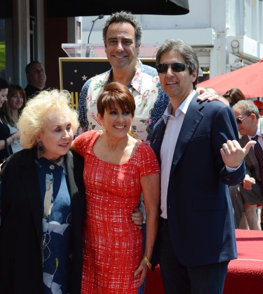 Actress Paricia Heaton (C) poses with her Everybody Loves Raymond cast members Doris Roberts, Brad Garrett and Ray Romano (L-R) during an unveiling ceremony honoring her with the 2,472nd star on the Hollywood Walk of Fame in Los Angeles on May 22, 2012. File Photo by Jim Ruymen/UPI