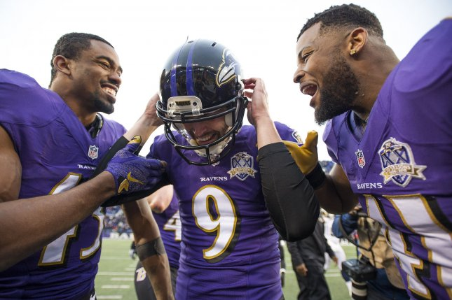 Baltimore Ravens kicker Justin Tucker (9) celebrates with teammates Anthony Levine (R) and Raheem Mostert after kicking the game winning 47-yard field goal to defeat the St. Louis Rams, 16-13, at M&T Bank Stadium in Baltimore, Maryland on November 22, 2015. Photo by Kevin Dietsch/UPI