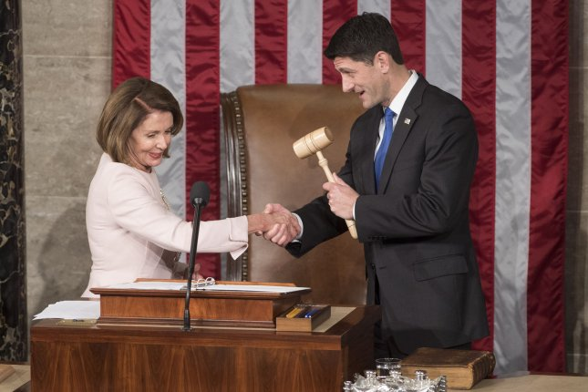 House Minority Leader Nancy Pelosi, D-Calif., shakes hands with House Speaker Paul Ryan, R-Wis., after his re-election to the post at the opening of the 115th Congress on Tuesday at the U.S. Capitol in Washington, D.C. Photo by Kevin Dietsch/UPI
