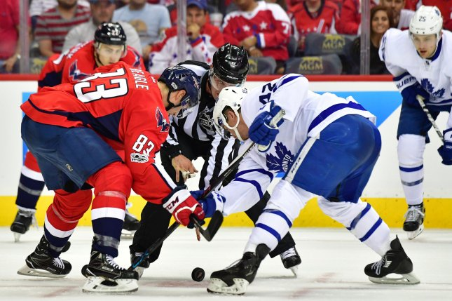 Washington Capitals center Jay Beagle (83) and Toronto Maple Leafs center Tyler Bozak (42) fight for the puck in the first period of the Eastern Conference Quarterfinals at the Verizon Center in Washington, D.C. on April 13, 2017. Photo by Kevin Dietsch/UPI