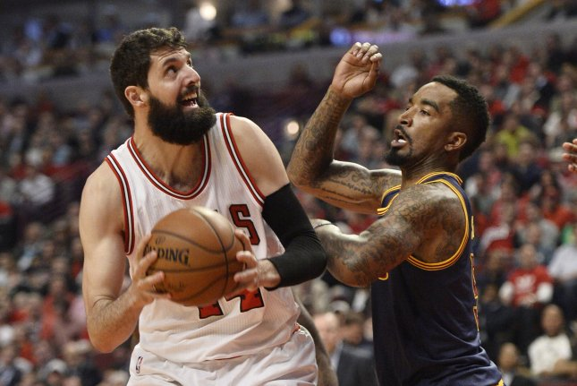 Chicago Bulls forward Nikola Mirotic goes up for a shot against Cleveland Cavaliers guard J.R. Smith. Photo by Brian Kersey/UPI