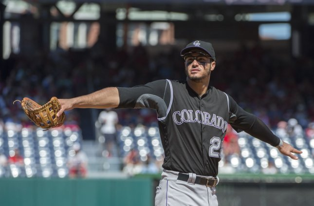 Kris Bryant hit in head with pitch, exits game vs. Rockies