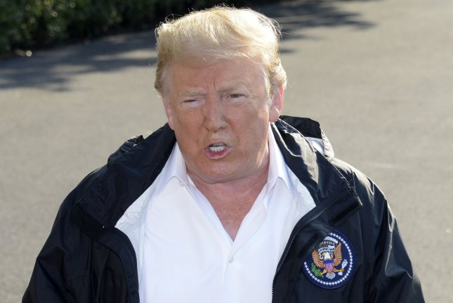 President Donald Trump makes remarks to the press as he departs the White House, Washington, DC, for a day trip to North Carolina to view Hurricane Florence damage, September 19, 2018. Trump will be briefed on rescue and recovery efforts after catastrophic flooding and numerous deaths. Photo by Mike Theiler/UPI