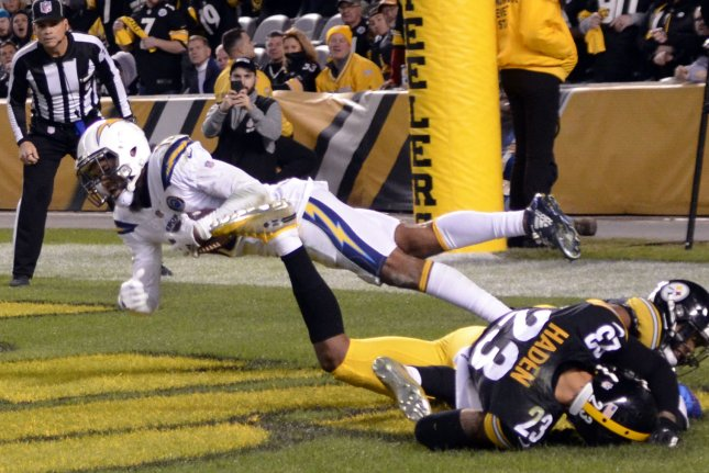 Los Angeles Chargers wide receiver Keenan Allen (13) pulls in the touchdown pass after the ball deflects off the Pittsburgh Steelers players in the third quarter of the Chargers 33-30 win against the Steelers on December 2 at Heinz Field in Pittsburgh. Photo by Archie Carpenter/UPI