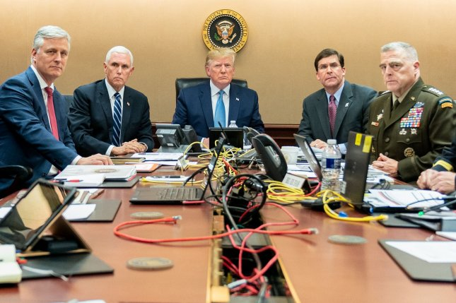 President Donald Trump is pictured in the Situation Room of the White House on October 26, monitoring U.S. Special Operations forces as they conduct a mission in Syria to capture or kill Islamic State leader Abu Bakr al-Baghdadi. Photo by Shealah Craighead/The White House/UPI