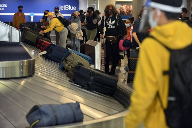 Thanksgiving holiday travelers thronged the Los Angeles International Airport as active COVID-19 cases and deaths continued to rise in the United States. Photo by Jim Ruymen/UPI