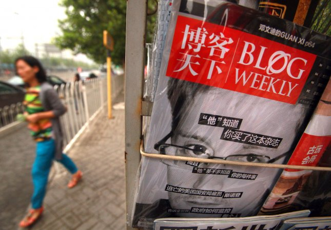 A popular Chinese magazine featuring a front-page story on American Edward Snowden is sold at a news stand in Beijing on June 25, 2013. China has expressed grave concern over U.S. spy agency contractor Snowden's allegations that the United States has hacked into computers in China, with one hub being the university where a few of China's Presidents have attended. UPI/Stephen Shaver