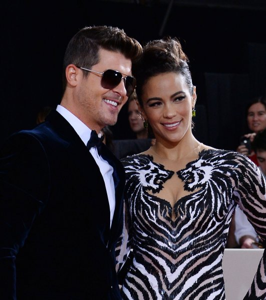 Recording artist Robin Thicke (L) and actress Paula Patton arrive for the 56th annual Grammy Awards at Staples Center in Los Angeles on January 26, 2014. UPI/Jim Ruymen