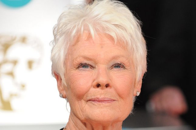 English actress Dame Judi Dench attends the EE British Academy Film Awards 2014 at The Royal Opera House in London on February 16, 2014. UPI/Paul Treadway