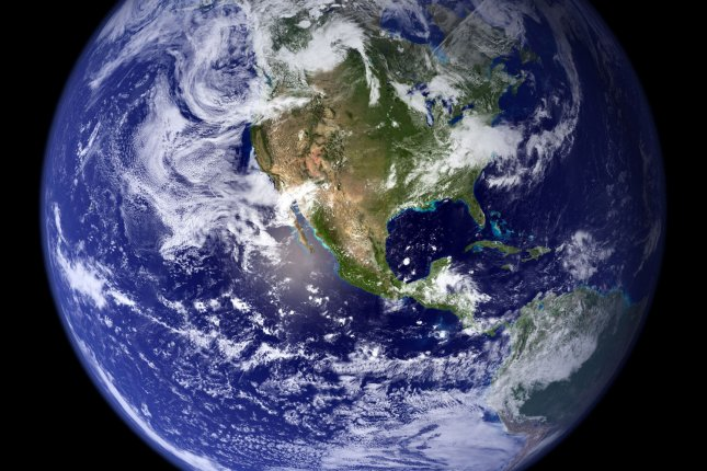 This February 2, 2002 NASA image shows the planet Earth as seen by NASA's Moderate Resolution Imaging Spectroradiometer on board the Terra satellite. This image is a compilation of images taken every eight days by the satellite between June2001 through September 2001. (UPI Photo/NASA)
