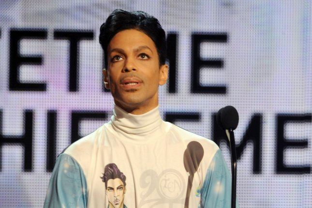Prince acknowledges the audience as he accepts the Lifetime Achievement award at the 2010 BET Awards in 2010. A judge ordered Friday that a DNA sample be taken from the singer's body out of concerns for potential future parentage claims against his estate. File Photo by Jim Ruymen/UPI