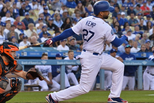 Los Angeles Dodgers outfielder Matt Kemp connects with a single in the bottom of the ninth against the San Francisco Giants on March 29 at Dodger Stadium in Los Angeles, Calif. Photo by Jim Ruymen