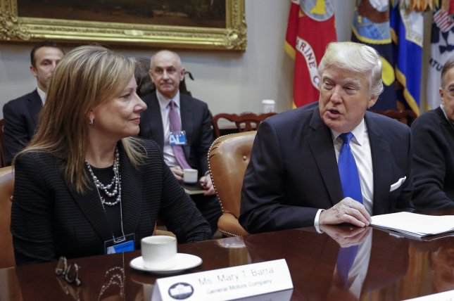 President Donald Trump and General Motors CEO Mary Barra speak during a January 24, 2017, meeting at the White House. Trump invoked the Defense Production Act on Friday to require GM to manufacture ventilators. File Photo by Shawn Thew/UPI
