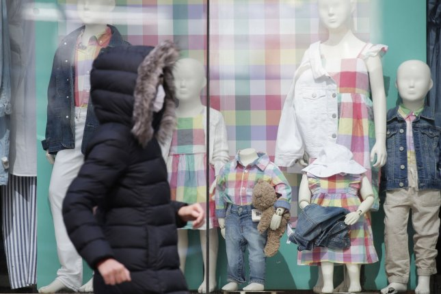 A pedestrian walks past a Gap Kids clothing store on 5th Avenue in New York City on April 19. File Photo by John Angelillo/UPI