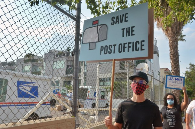 Activists rally to support the U.S. Postal Service and call for Postmaster General Lous DeJoy to resign at the Sunset Post Office in the Hollywood section of Los Angeles on Saturday. Photo by Jim Ruymen/UPI