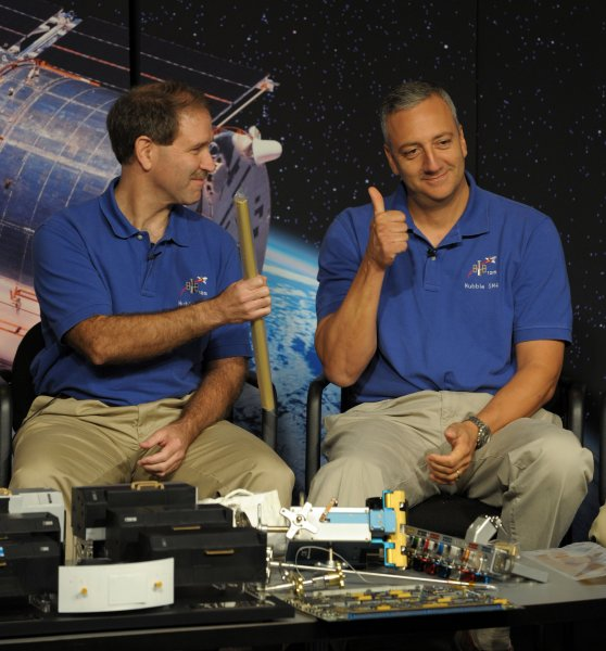 Astronauts John Grunsfeld (L) and Mike Massamino discuss Space Shuttle Atlantis mission STS-125, the May 2009 mission to repair Hubble, as NASA unveils new science from the recently refurbished Hubble Space Telescope at NASA headquarters in Washington on September 9, 2009. UPI/Roger L. Wollenberg