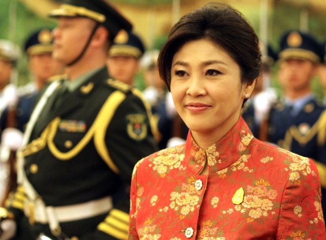Thai Prime Minister Yingluck Shinawatra walks past a military honor guard during a welcoming ceremony in the Great Hall of the People in Beijing April 17, 2012. Thailand's Constitutional Court overturned the results of the Feb. 2 general election on Friday ad said a new vote should be held.. UPI/Stephen Shaver