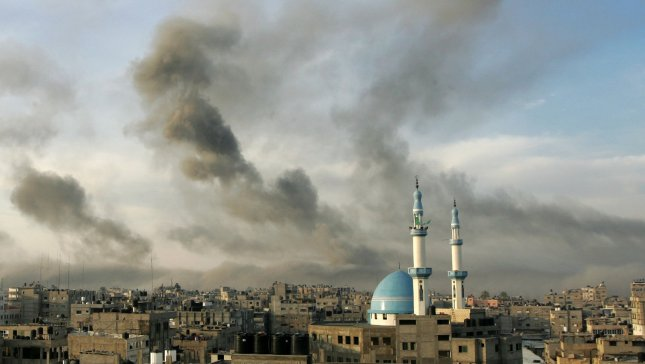 Smoke rises after Israeli air strikes in southern Gaza on November 21, 2012. Fighting raged on both sides of Gaza's borders Wednesday despite intensified efforts across the region to thrash out a truce to end a week of violence. UPI/Ismael Mohamad