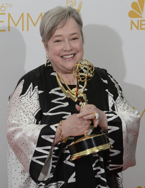 Kathy Bates holds her Emmy for Outstanding Supporting Actress in a Miniseries or Movie Award for 'American Horror Story: Coven.' (UPI/Phil McCarten)