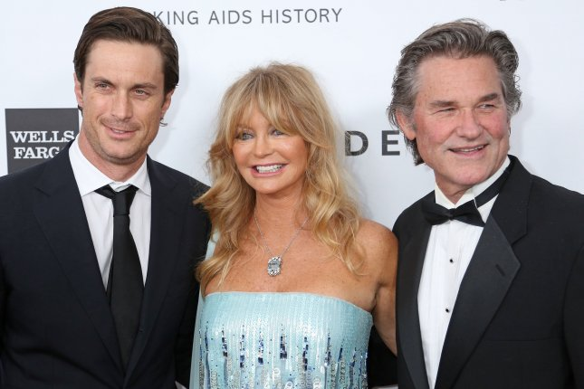 Oliver Hudson (L) with mom Goldie Hawn and her longtime partner, Kurt Russell, at the amfAR Inspiration Gala on December 12, 2013. The actor recently reconnected with his estranged dad, Bill Hudson. File Photo by David Silpa/UPi