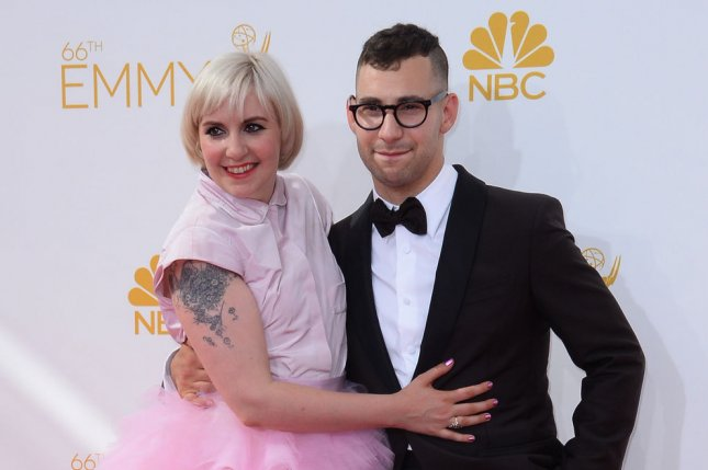 Lena Dunham (L) and Jack Antonoff at the Primetime Emmy Awards on August 25, 2014. The actress' series Girls will reportedly end after Season 6. File Photo by Jim Ruymen/UPI