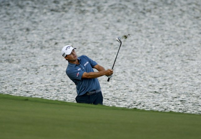 Kevin Kisner hits out of the rough during the third round of the PGA Championship at the Quail Hollow Club in Charlotte, N.C., on Saturday. Photo by Nell Redmond/UPI