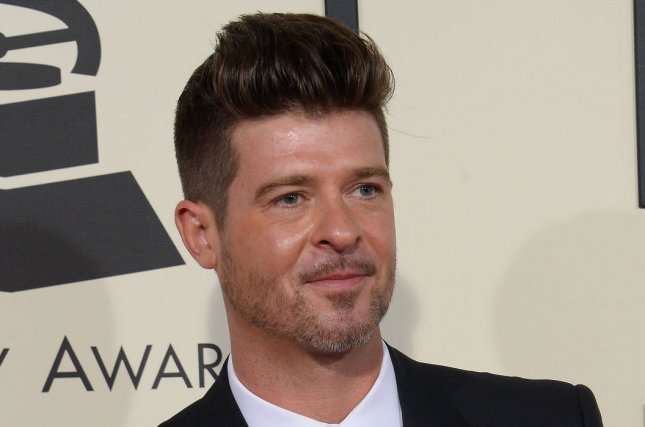 Robin Thicke attends the Grammy Awards on February 15, 2016. The singer shared a picture with April Love Geary and Julian, his son with ex-wife Paula Patton, on Saturday. File Photo by Jim Ruymen/UPI