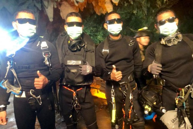 Four members of the Royal Thai Navy SEALS give a thumbs-up after rescuing 12 schoolboys, members of a local soccer team, and their coach, who were trapped in the Tham Luang Cave network in Northern Thailand. The 13 individuals had been trapped in the cave system for 18 days, their escape hampered and delayed by rising waters. Photo by Royal Thai Navy SEALS/UPI