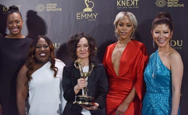 The Talk co-hosts, left to right, Aisha Tyler, Sheryl Underwood, Sara Gilbert, Eve and Julie Chen hold up their award for Outstanding Entertainment Talk Show at the 45th Annual Daytime Emmy Awards in Pasadena on April 29. File Photo by Chris Chew/UPI