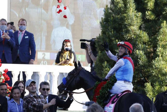 Jockey John Velazquez throws roses into the crowd after winning the 147th running of the Kentucky Derby on Saturday at Churchill Downs in Louisville, Ky. Photo by Jason Szenes/UPI